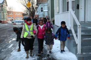 Students walk with volunteer Audrey.