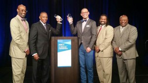 National PTA board member Dr. Calvin Mackie (left) accepts the Dr. Asa G. Hilliard Model of Excellence Award from the College Board during the 2015 A Dream Deferred conference.