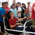 """Milton students test their texting and driving skills on driving simulators during a """"Don't Text and Drive"""" event running concurrently with AT&T's """"It Can Wait"""" campaign."""