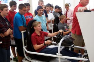 "Milton students test their texting and driving skills on driving simulators during a ""Don't Text and Drive"" event running concurrently with AT&T's ""It Can Wait"" campaign."