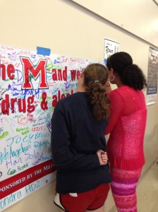 Milton students sign the pledge to be drug and alcohol free during Red Ribbon Week.