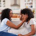 Mom talking to emotional teenage daughter