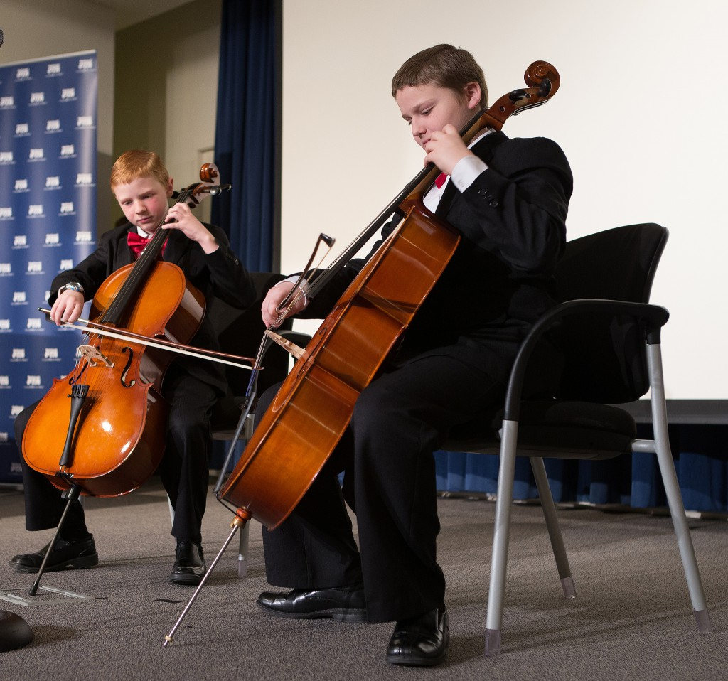 "Jarom Garner, left, and his sibling Adam perform Jarom's winning musical composition for cello, ""The Brothers' March."""