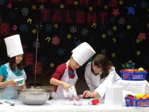 Photo credit: Chartwells – Kids cooking and measuring ingredients, Clintondale, MI